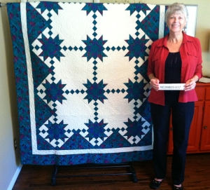 Micki Batté with her quilt